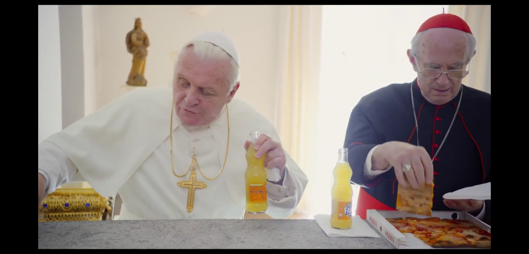 pope Benedict and pope Francis with two 500ml bottles of Fanta orange